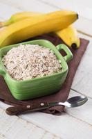 Oat flakes in bowl with banana photo