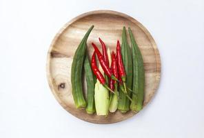 Fresh organic vegetable on wooden plate