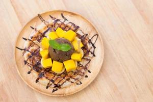 Chocolate ice cream on mango roti. photo