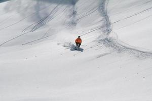 Skier in deep powder, extreme freeride photo
