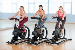 Cycling on exercise bikes. photo