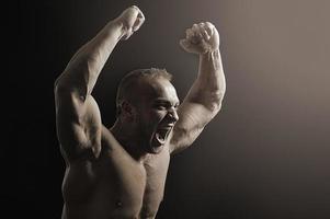 Bodybuilder posing photo