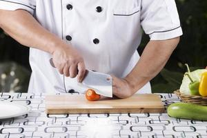 Chef slice tomato photo