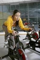 Woman exercising in the gym. photo