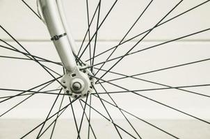 close up of bicycle wheels prosecc in vintage retro style photo