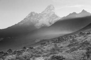 B&W Ama Dablam mountain peaks morning fog, Tengboche village, Nepal.