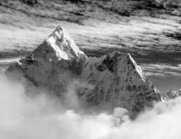 Black and white view of Ama Dablam with and beautiful clouds
