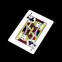 Jack clover card isolated on black photo