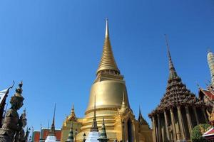 Golden pagoda in the Emerald Buddha Temple photo