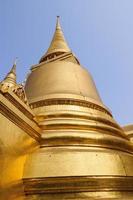 Golden pagoda at Wat Phra Kaew, Bangkok, Thailand photo