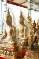 Buddha statues in plastic wrap