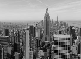 Tightly packed buildings and Manhattan skyline, New York City photo