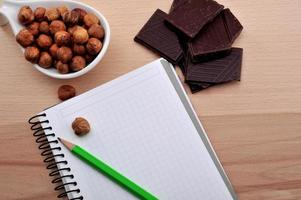 almonds,chocolate with blank recipe book