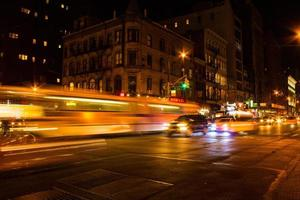 Faster moving bus at night in NYC photo