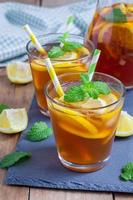 Refreshing homemade lemon iced tea on a black slate tray photo