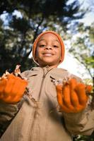 Boy with leaves photo