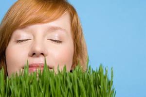 Woman smelling grass photo