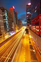 Road tunnels light trails on modern city buildings in HongKong