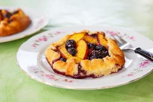 Fresh baked round cake with blueberry and peach photo