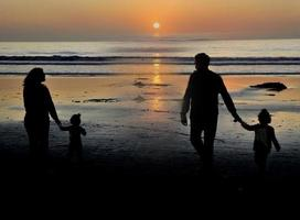 Family taking a stroll at sunset west coast USA