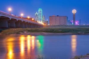 Downtown Dallas, Texas skyline at night reflecting in Trinity Ri photo