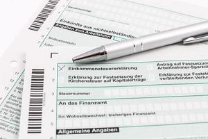 Form of income tax return with ball pen photo