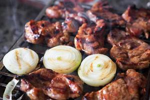 Pork chops on grill photo