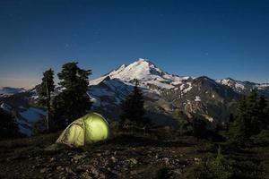 Glowing tent at night beneath Mount Baker, Washington state