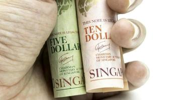 singapore dollars contant papier bankbiljet. Aziatische monetaire valuta.