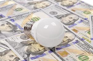Light bulb and dollar