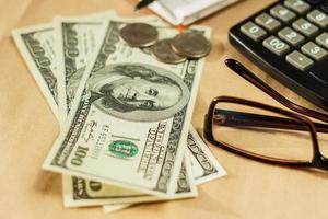Image of money and a calculator, home budget photo