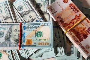 American dollars and Russian rubles photo