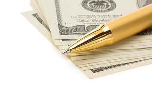 pen on dollar money banknotes photo