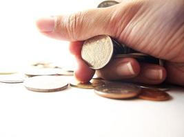 Coins in hand, fistful money photo
