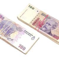 Two stacks of pesos. photo