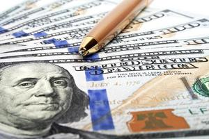 Business concept - money and pen