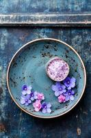 Flowers in bowl with sea ​​salt