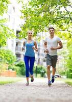 Couple jogging in the park photo