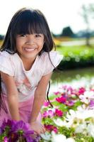 Little girl smiling with flowers field
