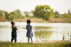 Two little girls fishing photo