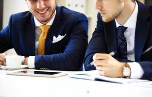 Two confident businessmen networking in office photo