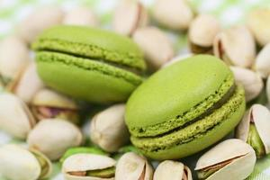 Pistachio macaroons on nuts, close up