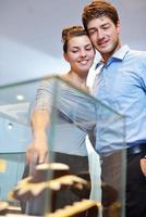 happy young couple in jewelry store photo