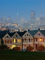 Landscape of Alamo square with cityscape in the background photo