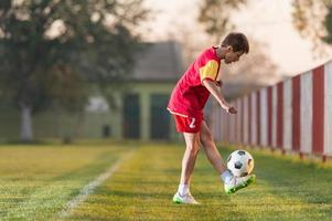 Child playing football photo