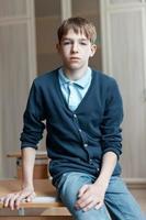 Portrait of serious teenage boy in class