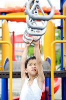 Boy hang bar photo