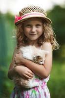 Cute little girl with a kitten photo