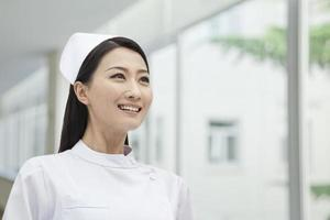 Portrait of Nurse, China, horizontal photo