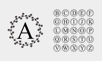 Black alphabet in circle flower frame vector